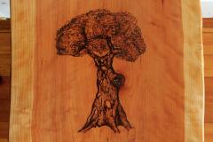 Trevor Rubin - That Assumption Trunk - 2018 - Pyrography on cherry wood slab - 17x14 - $300