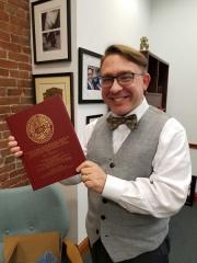 Kurt with Dissertation Book from Northwestern University