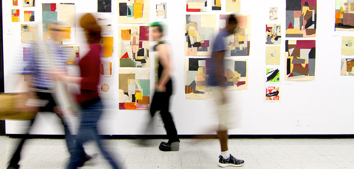 students walking through halls of Montserrat. Collage artwork on wall